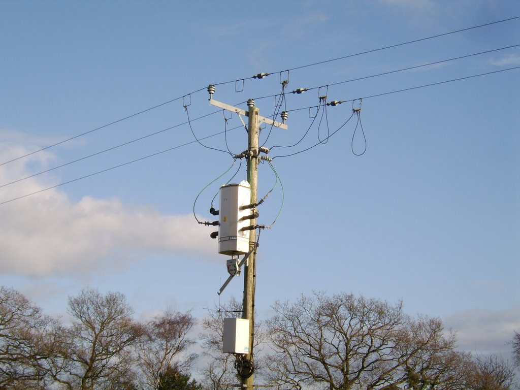 A photograph of three high powerlines
