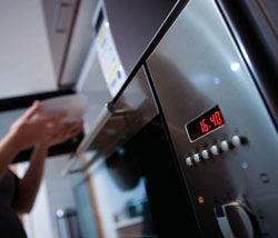 Closeup of an oven showing the timer at 16.40